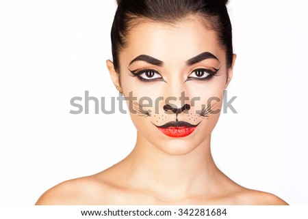 Beauty woman with makeup in cat style. Fashion makeup model face. Luxury girl with trendy make up. Isolated on white. - stock photo