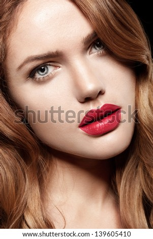 Beauty Woman with Perfect Makeup. Pink Lips and Nails.  Closeup portrait of young lady