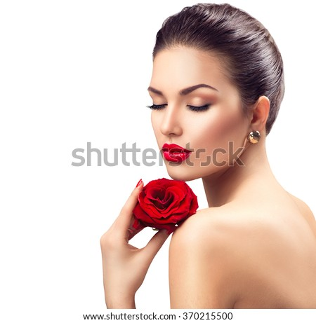 Beauty Woman with Red Rose flower. Red Lips and Nails. Beautiful Luxury Makeup and Manicure. Fashion Model Girl Portrait Isolated on a white background - stock photo