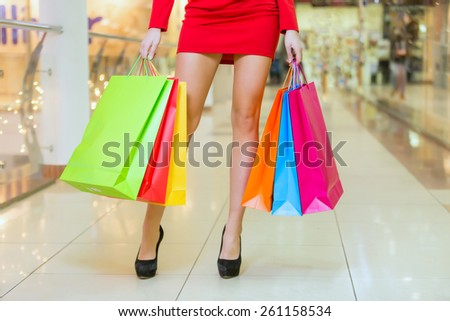 Beauty Woman With Shopping Bags In Shopping Mall. Sale Concept - stock photo