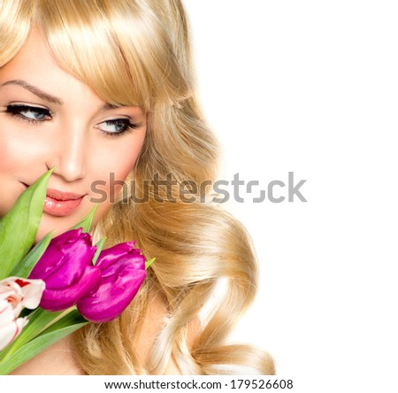 Beauty Woman with Spring Flower bouquet. Beautiful girl with a Bouquet of Tulip flowers. Isolated on a white background. Happy surprised model woman smelling flowers. Mothers Day - stock photo