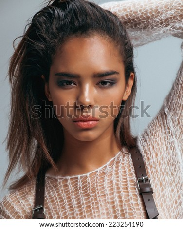 beauty young afro woman in sweater close up, sexy winter look - stock photo