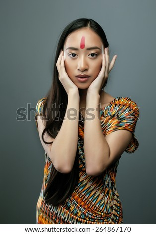 beauty young asian girl with make up like Pocahontas, red indians woman fashion - stock photo