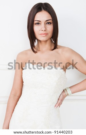 Beauty young bride dressed in elegance white wedding dress - stock photo