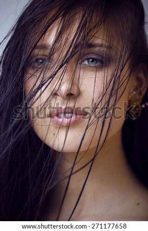 beauty young brunette sad woman close up,real spa hair on face