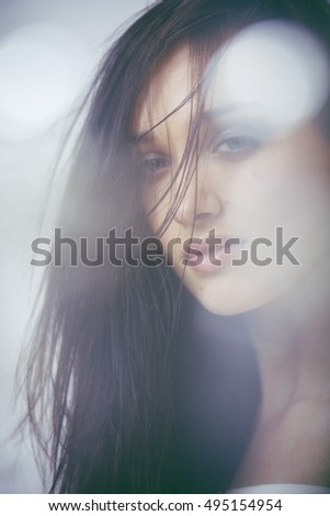 beauty young brunette sad woman close up,real spa hair on face inspiring