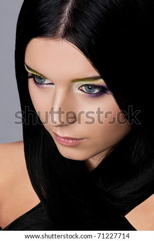 Beauty Young Brunette Woman on blue background Beauty face woman with make-up - stock photo