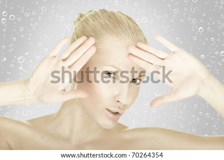 beauty young female with a drops of water - stock photo