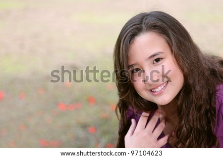 beauty young girl smiling and looking at the camera