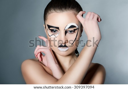 Beauty young girl with makeup geometric shapes