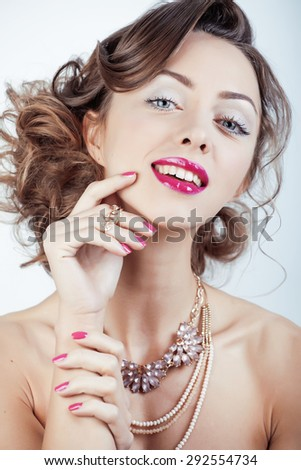beauty young luxury woman with jewellery, rings, nails close up on white isolated - stock photo