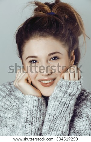 beauty young real woman in sweater at winter warmed up, cheerful smiling closeup cold winter - stock photo