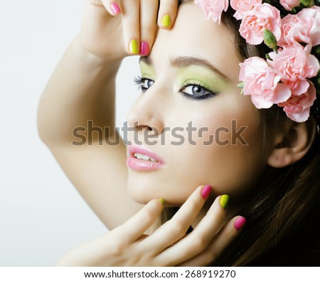 Beauty young real woman with flowers and make up closeup, nails with manicure - stock photo