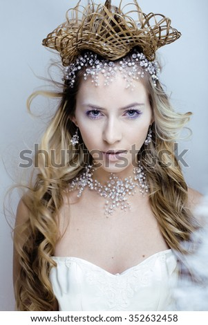 beauty young snow queen in fairy flashes with hair crown on her head close up winter tale - stock photo