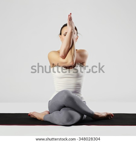 beauty young woman doing yoga.healthy stretching yoga girl