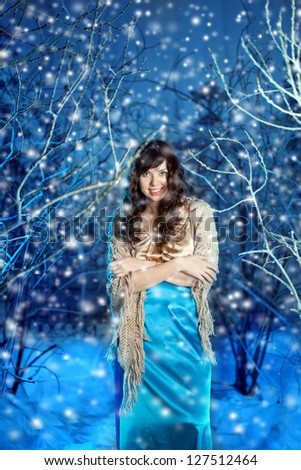 Beauty young woman in winter forest