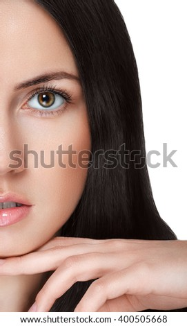 Beauty young woman portrait. Professional sensual makeup for brunette with brown eyes.Beautiful model girl. Perfect healthy skin.Isolated on white background.Part of face.Hand attached to the chin - stock photo