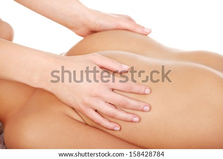 Beauty young woman relaxing in spa. Breast massage.  - stock photo