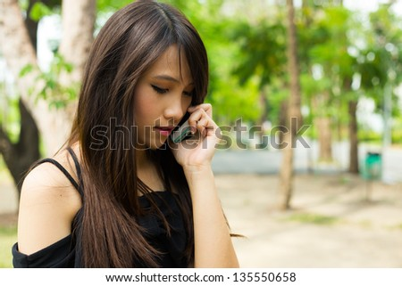 Beauty young woman smiling in the park - stock photo