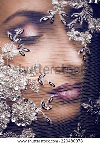 beauty young woman throw white lace close up, bride under veil - stock photo