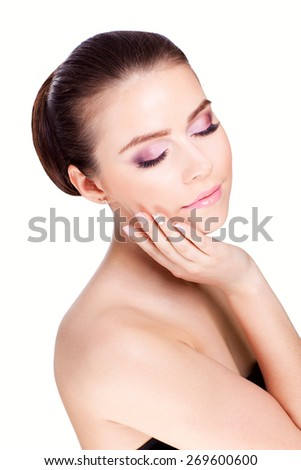 Beauty young woman with close eyes isolated on white background