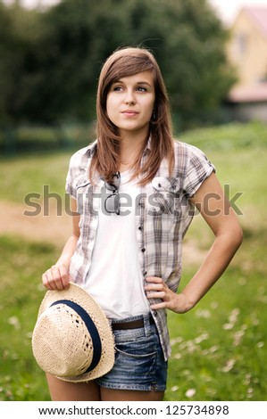Beauty young woman with fedora hat in hand - stock photo