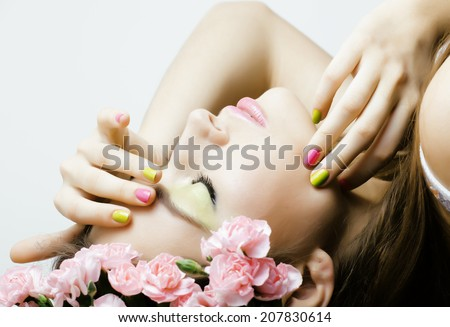 Beauty young woman with flowers and makeup close up, spa treatment - stock photo