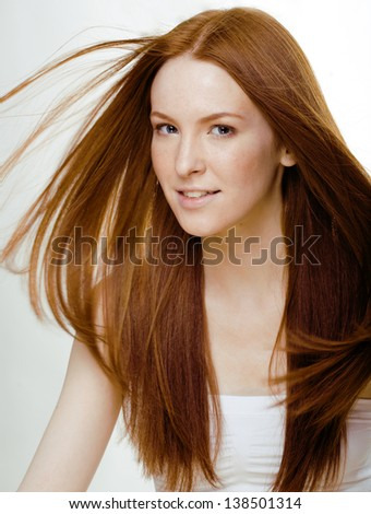 beauty young woman with red flying hair - stock photo