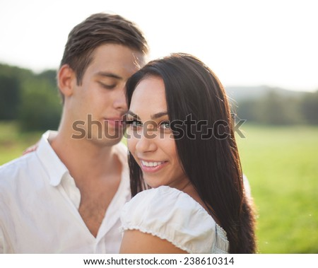 Beautyful young couple happy in nature