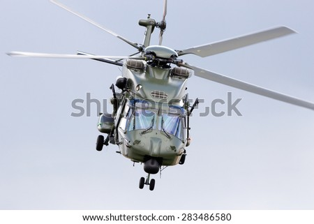 BEAUVECHAIN, BELGIUM - MAY 20, 2015: The new Belgian army NH90 helicopter taking off from Beauvecahin airbase. The first helicopters entered service in 2013  - stock photo