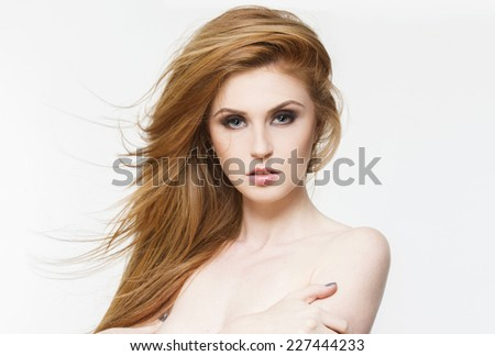 beauyiful young woman with red healthy hair and perfect skin