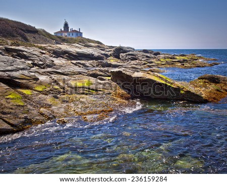 Beavertail Lighthouse in Newport, Rhode Island on a sunny day - stock photo
