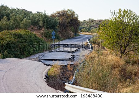 Because of the violation of technology in the construction of roads, water washed away roads and formed a failure  - stock photo