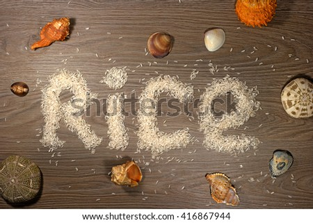 Because rice is laid out on a wooden floor panels -Rice-. The composition of sea shells added. - stock photo