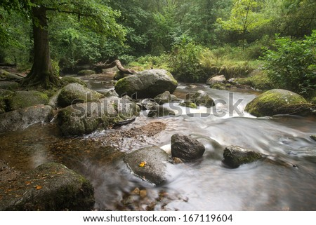 Becky Falls waterfall landscape in Dartmoor National Park England
