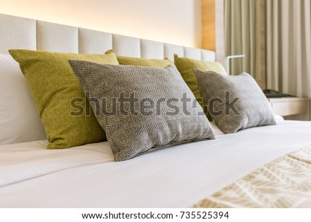 bed and pillows in modern bedroom