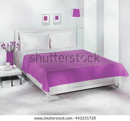 Bed and plain purple bedspread - stock photo