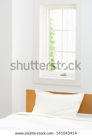 bed in a hotel bedroom - stock photo