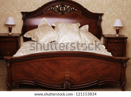Bed in a hotel room - stock photo