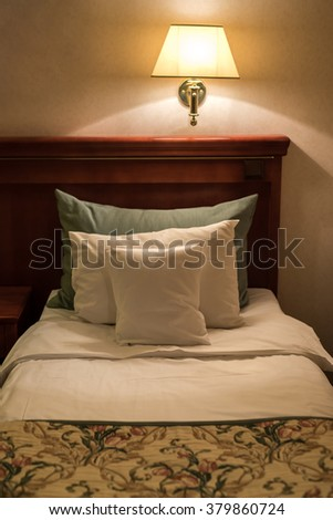 Bed in a hotel room at night
