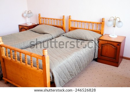 bed in motel room  - stock photo