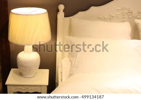 Bed in the interior with lamps