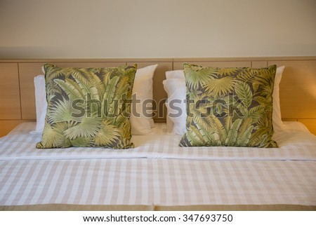 Bed room in hotel with nature pillow. - stock photo