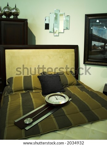 bed room set with CLOCK on the bed - stock photo
