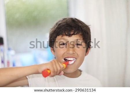 Bed time - boy brushes his teeth - very shallow depth of field