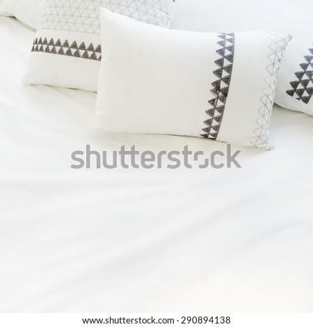 Bed with elegant white bed linen and pillows. - stock photo