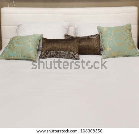 Bed with pillows  in a new house. - stock photo