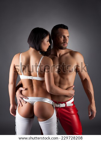 Beddable striptease performers posing at camera - stock photo
