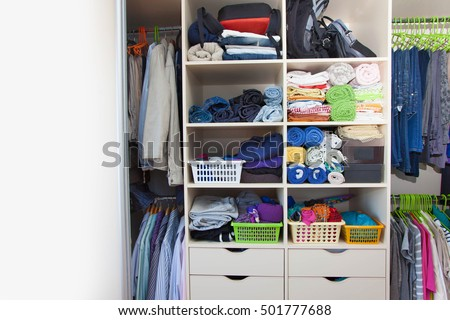 Bedding Is In The Closet On The Shelf. Towels Folded In A Roll. On