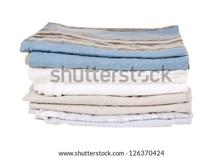 Bedding sheets folded and isolated on white - stock photo